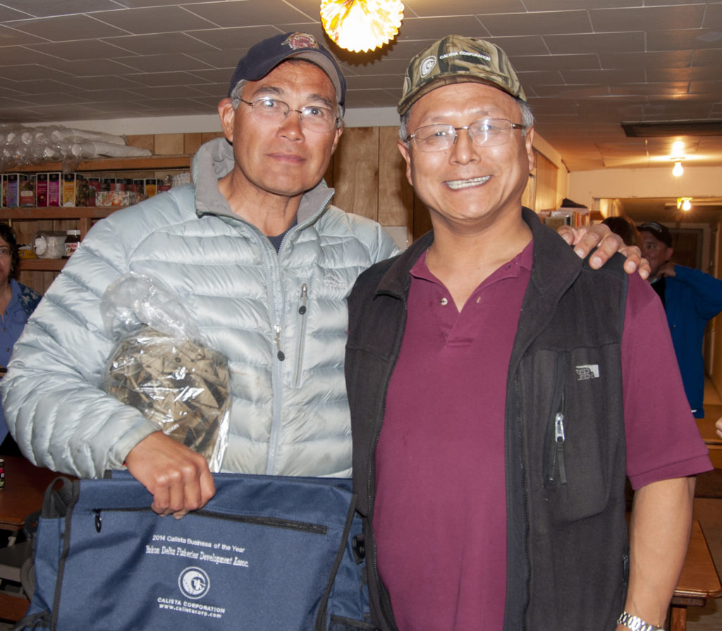 Ragnar Alstrom (L), executive director of Yukon Delta Fisheries Development Association, with Andrew Guy (R), Calista Corporation President/CEO.