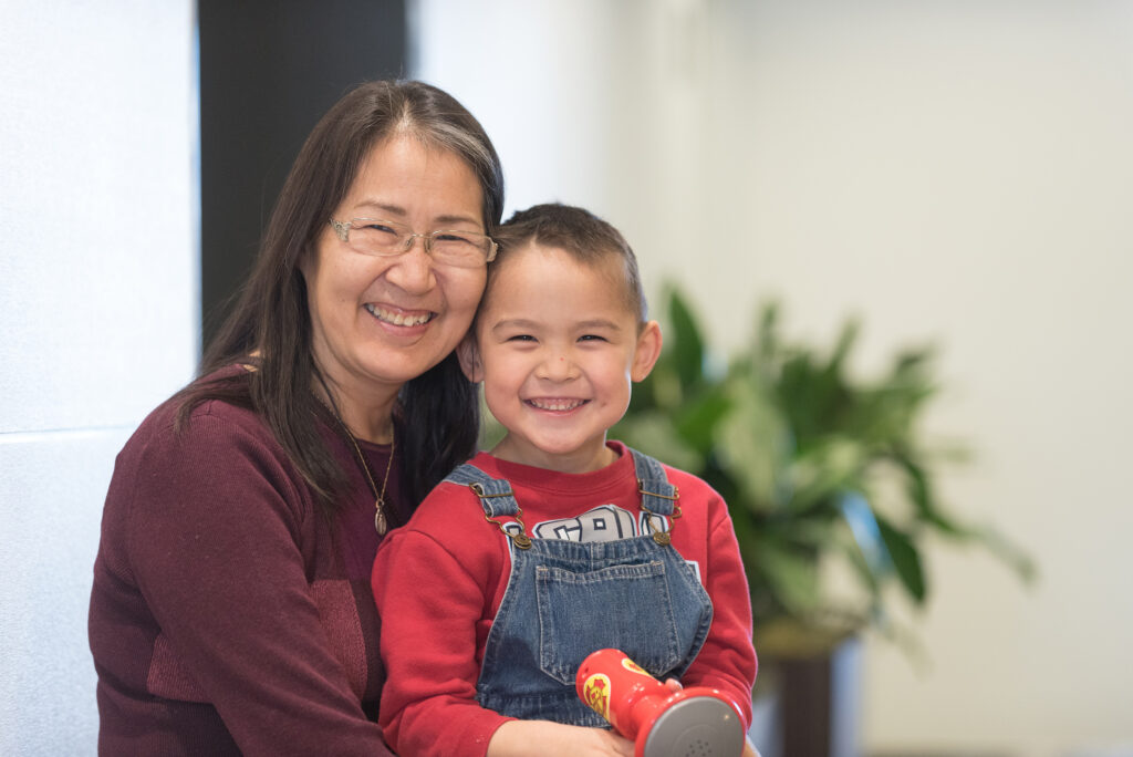 Eliza Meier, Calista Shareholder and Proxy Prize Winner, with her grandson.