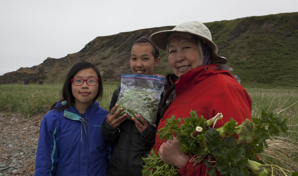 CECI Culture Camp students with Elder Ruth Jimmie gathering plants.